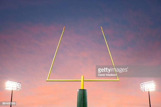 football goalpost and lights. - ゴールポスト ストックフォトと画像
