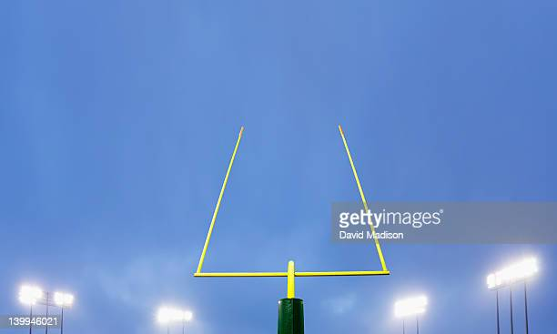 football goalpost and stadium lights. - goal post stock pictures, royalty-free photos & images