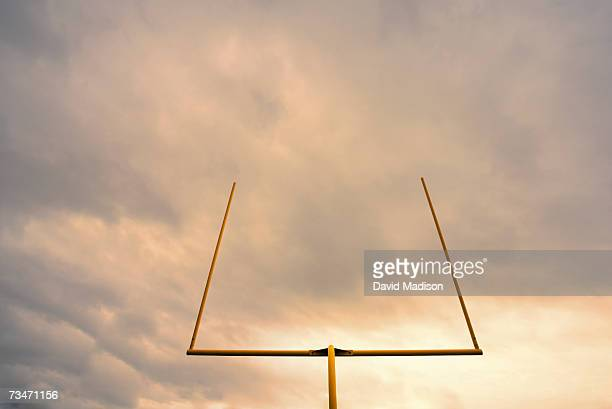 Football goalposts, low angle view, sunrise