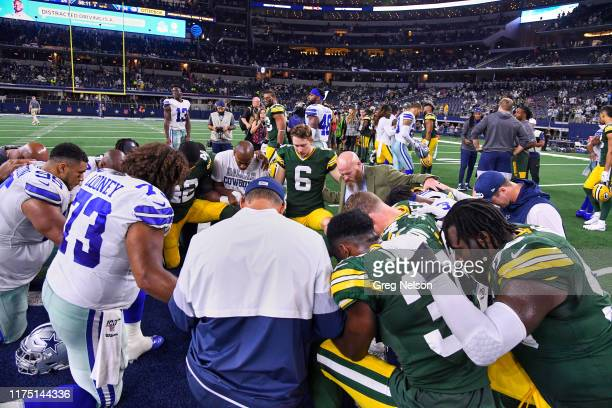 Green Bay Packers and Dallas Cowboys players praying on field after game at ATT Stadium Arlington TX CREDIT Greg Nelson