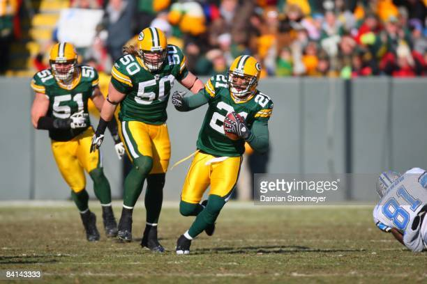 Green Bay Packers cornerback Charles Woodson in action runs after 1st quarter interception vs Detroit Lions Green Bay WI CREDIT Damian Strohmeyer