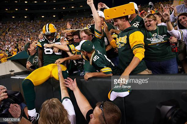 Green Bay Packers Donald Driver victorious after touchdown with fans vs Indianapolis Colts during preseason Green Bay WI 8/26/2010 CREDIT John Biever