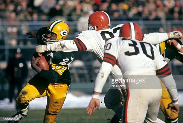 Green Bay Packers Elijah Pitts in action vs Cleveland Browns Jim Houston at County Stadium Milwaukee WI CREDIT Neil Leifer