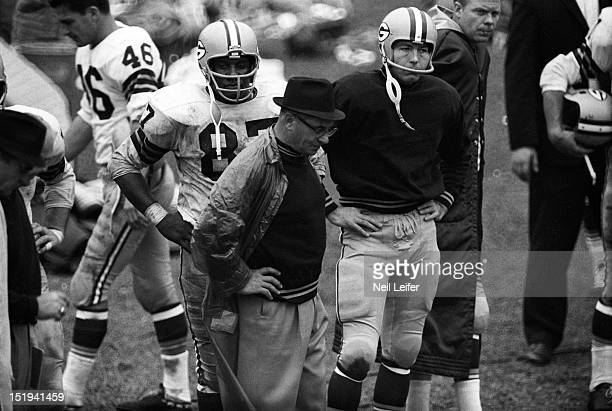 Green Bay Packers head coach Vince Lombardi and QB Bart Starr on sidelines during game vs Chicago Bears at Wrigley Field Chicago IL CREDIT Neil Leifer