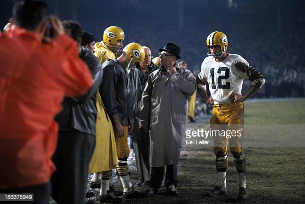 Green Bay Packers head coach Vince Lombardi and QB Zeke Bratkowski on sidelines during game vs Baltimore Colts at Memorial Stadium Baltimore MD...