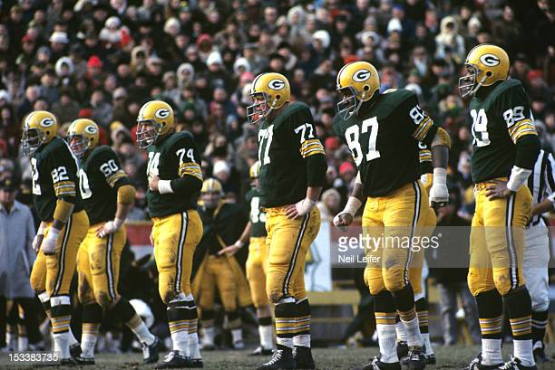 Green Bay Packers Lionel Aldridge Lee Roy Caffey Henry Jordan Ron Kostelnik Willie Davis and Dave Robinson on field during game vs Baltimore Colts at...