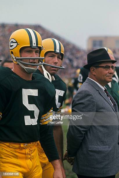 Green Bay Packers Paul Hornung QB Bart Starr and head coach Vince Lombardi on sidelines during game vs Baltimore Colts at City Stadium Green Bay WI...