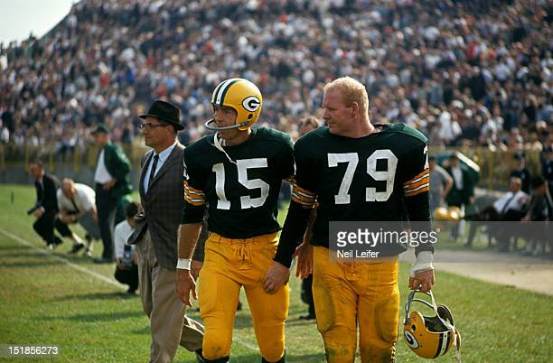 Green Bay Packers QB Bart Starr and Dave Hanner on sidelines during game vs Chicago Bears at City Stadium Green Bay WI CREDIT Neil Leifer