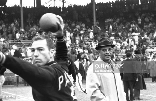 Football Green Bay Packers QB Bart Starr in action with coach Vince Lombardi before game vs Chicago Bears Chicago IL