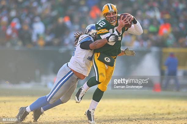 Green Bay Packers quarterback Aaron Rodgers in action tackled vs Detroit Lions defensive tackle Langston Moore Green Bay WI CREDIT Damian Strohmeyer