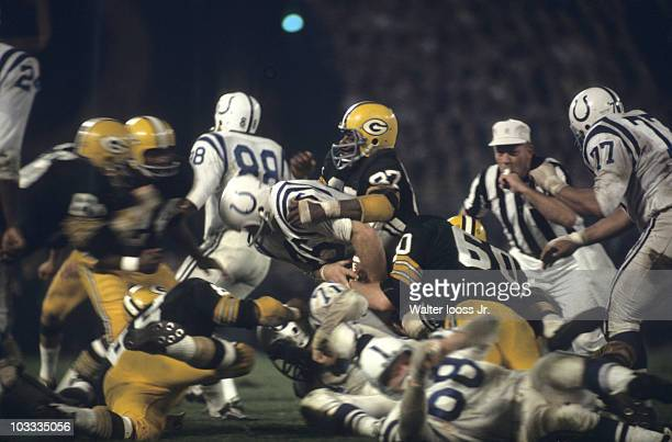 Green Bay Packers Willie Davis in action vs Baltimore Colts Jerry Hill Green Bay WI 9/10/1966 CREDIT Walter Iooss Jr