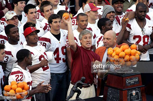 USC football head coach Pete Carroll throws oranges into the crowd during a rally to celebrate the team's 2004 National Championship on the USC...