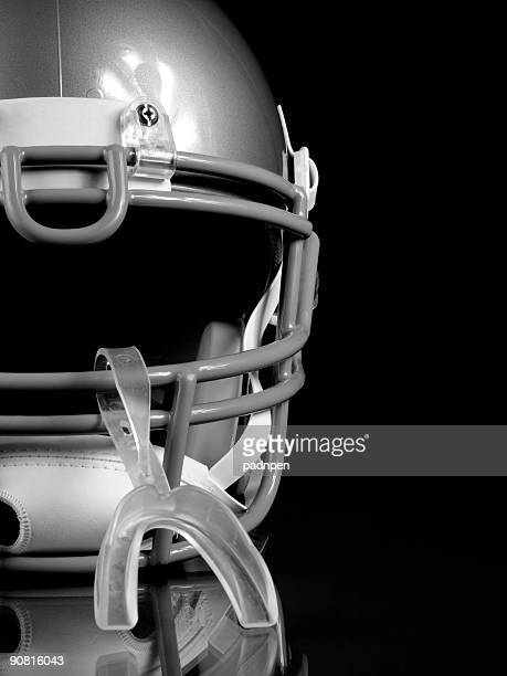 football helmet - b&w - wide receiver athlete stock photos and pictures