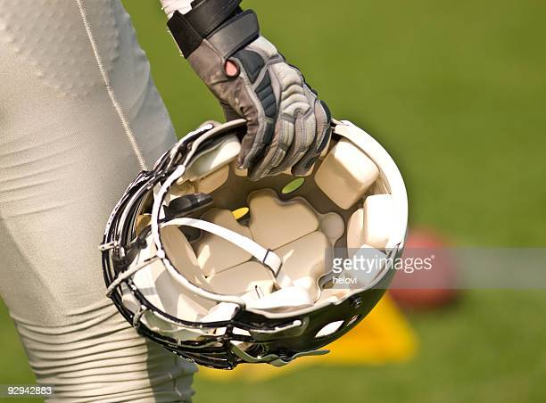 Football Helmet in hand