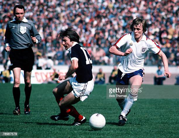 Football Home Championship 20th May 1978 Scotland 0 v England 1 Stuart Kennedy of Scotland is pursued by Peter Barnes of England