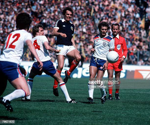 Football Home Championship Hampden Park Scotland 24th May 1980 Scotland 0 v England 2 Joe Jordan of Scotland plays the ball past Phil Thompson and...