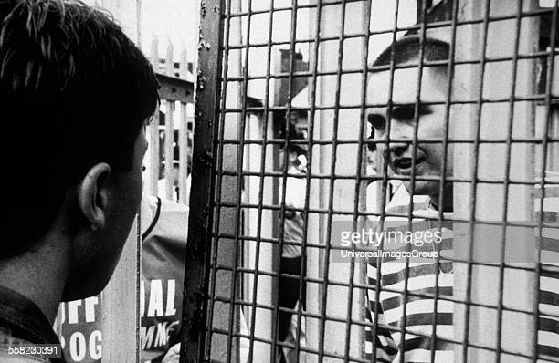 Football hooligans fence Stoke V Birmingham City UK 1992
