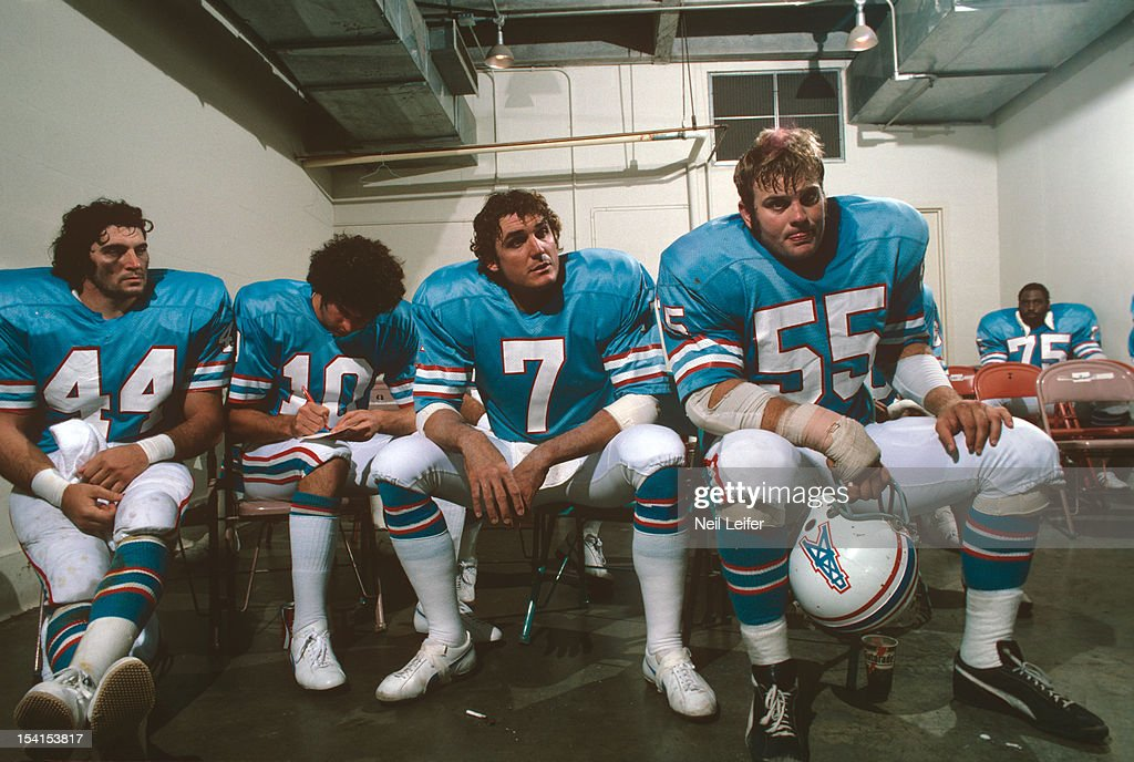 Houston Oilers Fred Willis Lynn Dickey Dan Pastorini Carl Mauck seated  during practice at Houston Astrodome a52debc31