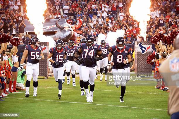 Houston Texans Chris Myers Jeff Maehl Wade Smith and QB Matt Schaub leading teammates onto field before preseason game vs San Francisco 49ers at...