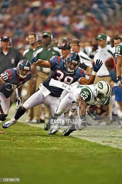 Houston Texans Danieal Manning in action, tackle vs New York Jets Shonn Greene during preseason game at Reliant Stadium. Houston, TX 8/15/2011...