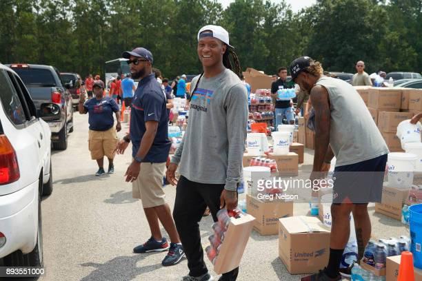 Houston Texans DeAndre Hopkins in parking lot preparing distribution of goods for Hurricane Harvey Relief Houston TX CREDIT Greg Nelson