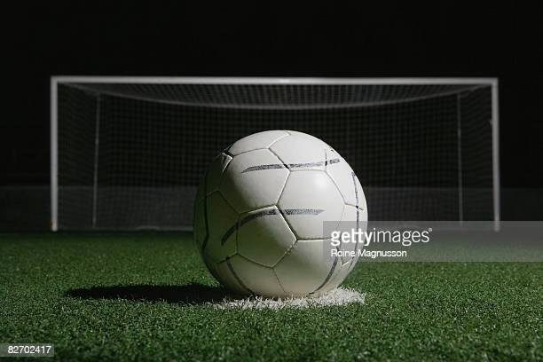 football in front of goal at night - goal post stock pictures, royalty-free photos & images