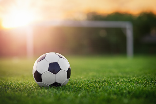 Football in the sunset 533861572