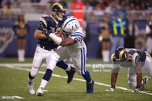 Indianapolis Colts Dwight Freeney in action making sack vs St Louis Rams QB Marc Bulger St Louis MO CREDIT David E Klutho