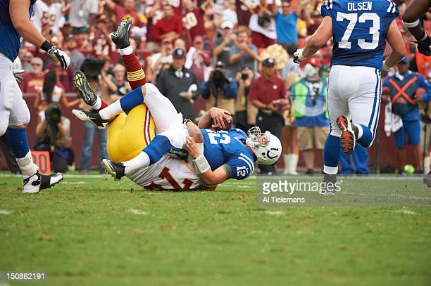 Indianapolis Colts QB Andrew Luck in action being sacked vs Washington Redskins Stephen Bowen during preseason game at FedEx Field Landover MD CREDIT...