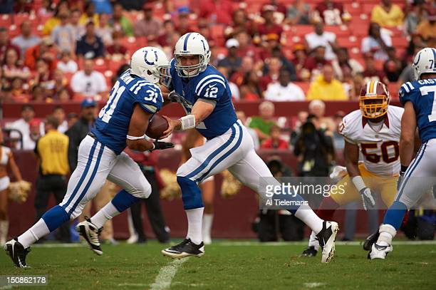 Indianapolis Colts QB Andrew Luck in action handoff to Donald Brown vs Washington Redskins during preseason game at FedEx Field Landover MD CREDIT Al...
