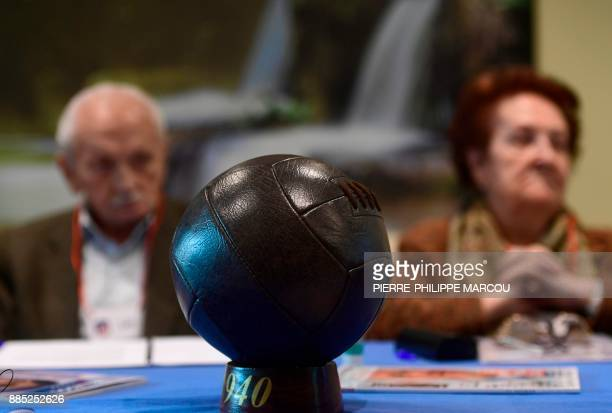 A football is placed on a table as patients affected by Alzheimer's disease attend a special therapeutic session in Madrid on November 28 2017 / AFP...