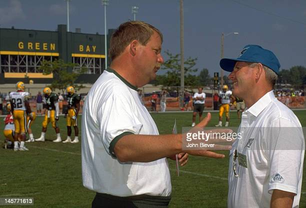 Jacksonville Jaguars head coach Tom Coughlin on field with Green Bay Packers head coach Mike Holmgren during Packers training camp practice at West...