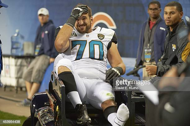 Jacksonville Jaguars Luke Bowanko being carted off of field after sustaining injury during preseason game vs Chicago Bears at Soldier Field Chicago...