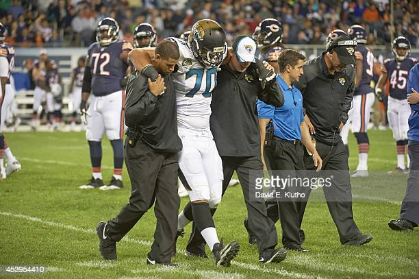 Jacksonville Jaguars Luke Bowanko being helped off of field after sustaining injury during preseason game vs Chicago Bears at Soldier Field Chicago...
