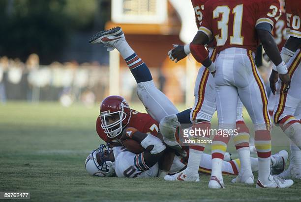 Kansas City Chiefs Art Still in action making tackle vs Miami Dolphins Ron Davenport Miami FL 9/22/1985 CREDIT John Iacono