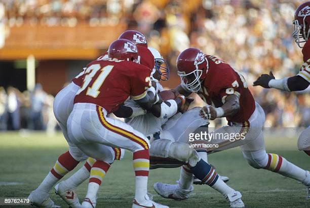 Kansas City Chiefs Art Still in action making tackle vs Miami Dolphins Tony Nathan Miami FL 9/22/1985 CREDIT John Iacono