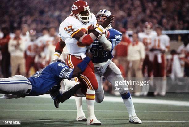 Kansas City Chiefs Joe Delaney in action during tackle by Detroit Lions at Pontiac Silverdome Pontiac MI CREDIT John Iacono