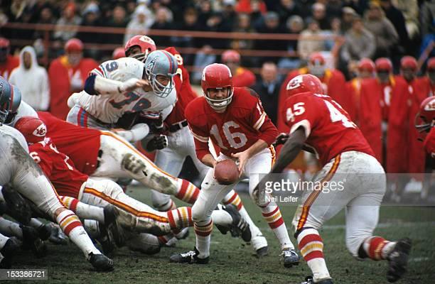 Kansas City Chiefs QB Len Dawson in action handoff to Robert Holmes during game vs Houston Oilers at Municipal Stadium Kansas City MO CREDIT Neil...