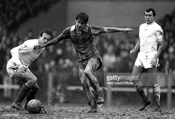 Football League Division One Swansea City v Stoke City Alan Curtis is caught by the muddy arm of Stoke player Paul Bracewell as they clash in the...
