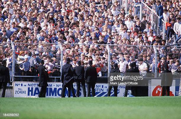 Football League Notts County v Manchester City City fans pull down fencing in front of the police