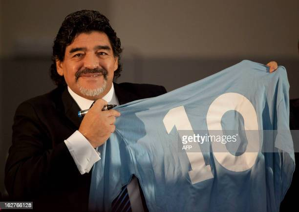 Football legend Argentinian Diego Maradona kisses a SSC Napoli number 10 jersey during a press conference on February 26, 2013 in Naples. Maradona,...