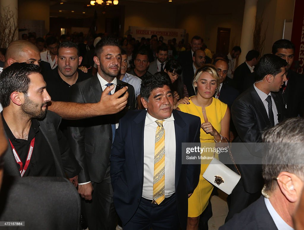 Football legend Diego Armando Maradona tours the exhibition of Soccerex brands on the second day of Soccerex convention, the world's largest football business event in Jordan bringing together global leaders in the business of football to debate network and do business on May 4, 2015 at the King Hussein convention centre, Dead Sea, Jordan.