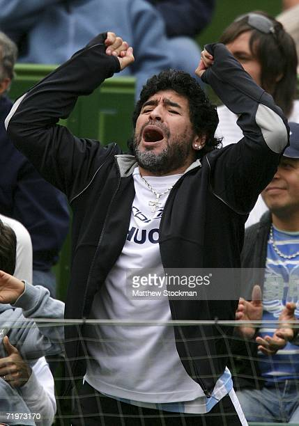 Football legend Diego Maradona cheers as Jose Acasuso of Argentina plays Lleyton Hewitt of Australia during the World Group Semifinal of the Davis...