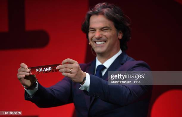 Football legend Fernando Couto of Portugal draws the name of Poland during the official draw for the FIFA U 20 World Cup at the Gdynia Arena on...