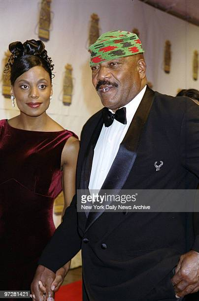 Football legend Jim Brown and wife Monique at Sports Illustrated's 20th Century Sports Awards at Madison Square Garden Brown was honored as the best...