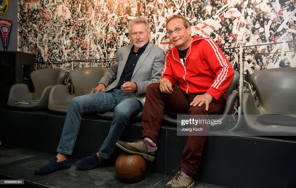 Football legend Paul Breitner (L) and host Wigald Boning attend the preview screening of the new documentaries 'Deutschland - Deine Fussballseele' and 'Magische WM-Momente - Tore, Traeume & Triumphe: 7 zu 1' as part of the TV event 'History of Football' by TV channel HISTORY at sports bar 'Stadion an der Schleissheimerstrasse' on May 15, 2018 in Munich, Germany.