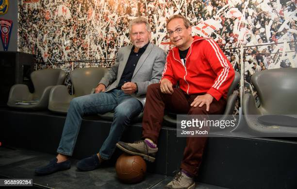 Football legend Paul Breitner and host Wigald Boning attend the preview screening of the new documentaries 'Deutschland Deine Fussballseele' and...