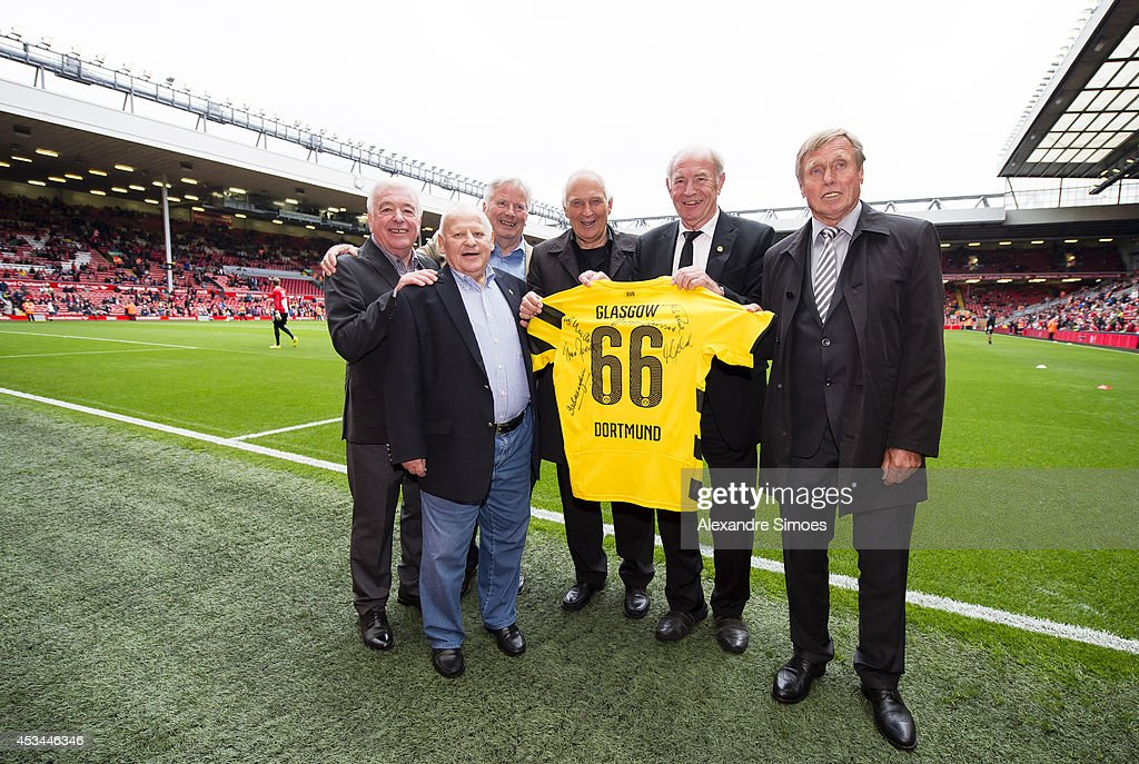 Football legends Ian Callaghan, Hoppy Kurrat, Theo Redder, Aki Schmidt, Wolfgang Paul and Sigi Held before the pre season friendly match between Liverpool FC and Borussia Dortmund at Anfield on August 10, 2014 in Liverpool, England.