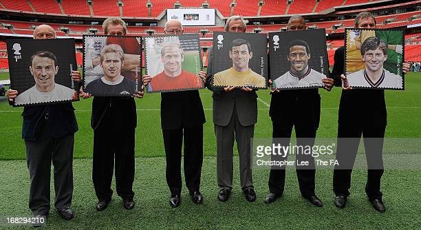 Football legends Jimmy Greaves, Denis Law, Sir Bobby Charlton, Gordon Banks, John Barnes and Bryan Robson pose for the camera with their stamps...