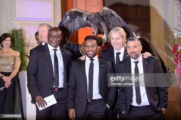 Football legends of Eintracht Frankfurt Anthony Yeboah, Jay-Jay Okocha, Jan Age Fiortoft and Oka Nikolov and Eintracht Frankfurt mascot eagel Attila...